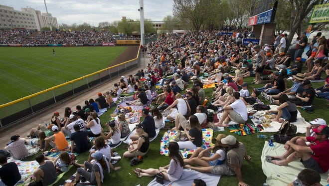 Cactus League fans fill the outfield lawn at Scottsdale Stadium, spring-training home of the San Francisco Giants. Games often attract large crowds, so if you don't have a ticket, be sure to check that your desired game isn't sold out before you start driving.