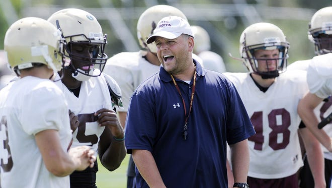 Dominick DeMatteo shown conducting practice at Arlington High School on Aug. 23, 2013 in Freedom Plains. DeMatteo was recently appointed as Nyack's new football coach.