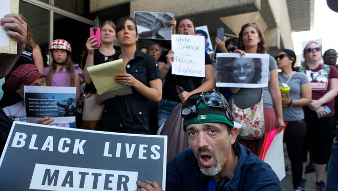 Scott Johnson repeated the names of people killed during altercations with police during a Black Lives Matter rally. July 10, 2016.