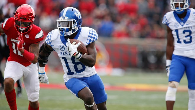 UK's Stanley Williams scampered for a touchdown against Louisville. Nov. 26, 2016.