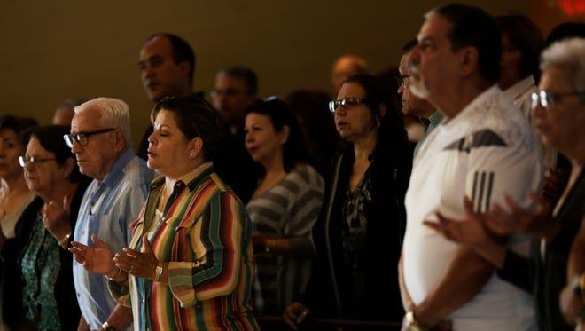 Attendees celebrate Mass at Ermita de la Caridad in Miami on Sunday, Nov. 27, 2016.