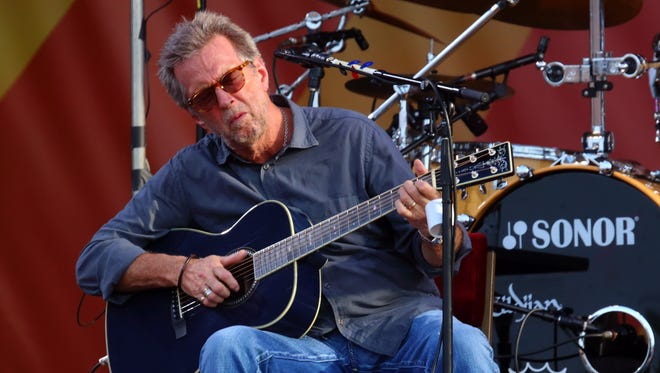 In this April 27, 2014, file photo, Eric Clapton performs at the 2014 New Orleans Jazz & Heritage Festival.
