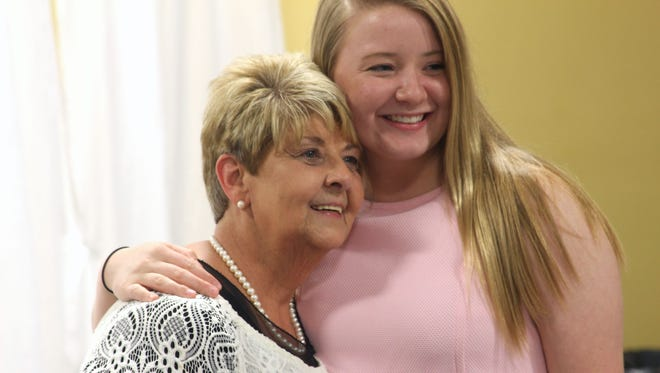 Sharon Tomlinson, left, retired from working for the Houston County court system after 24 years on May 30, 2017. She celebrated with her granddaughter Kara Fulcher, right, and the rest of her family and friends at Tennessee Ridge Baptist Church.