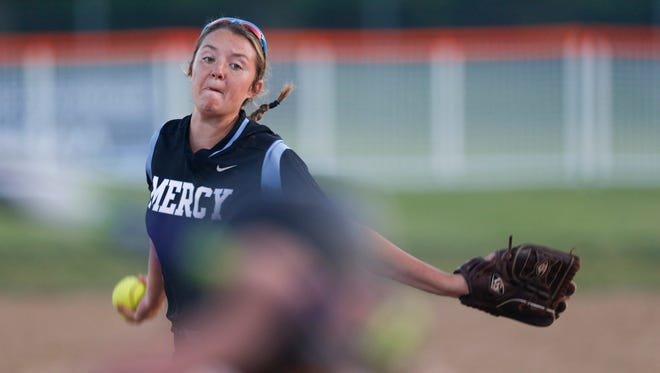 Mercy Academy pitcher Lexi Ray throws a pitch Thursday night against Woodford County in the second inning during the first round of the KHSAA softball state championship in Owensboro, Ky. June 8, 2017