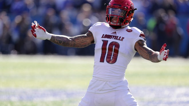 Louisville's Jaire Alexander tries to fire up the crowd during first half action against UK. Nov. 25, 2017
