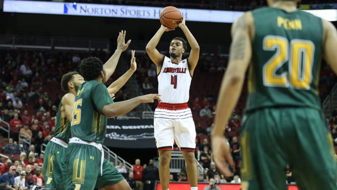 U of L's Quentin Snider pulls  up for a jumper during the second half against the visiting Siena Saints on Wednesday evening at the KFC Yum! Center. U of L came on strong in the second half to take an 86-60 victory. Dec. 6, 2017