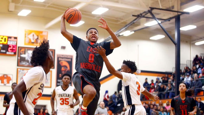 East Nashville's Taras Carter (0) goes for a shot past Stratford's taShaen Coleman (3) during their game, Friday, Jan. 5, 2018, in Nashville, Tenn. (Photo by Wade Payne, Special to the Tennessean)