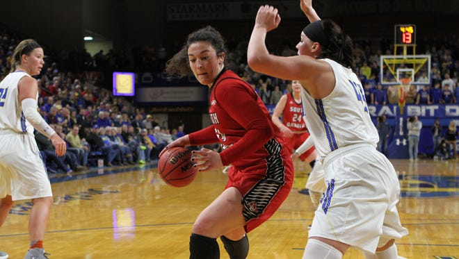 South Dakota's Kate Liveringhouse (34) drives to the bucket against South Dakota State's Ellie Thompson in the second quarter.