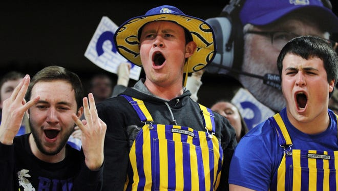 South Dakota State fans yell after a made three-pointer during the first half of the Jackrabbits' 76-72 victory over South Dakota  Thursday night at Frost Arena.