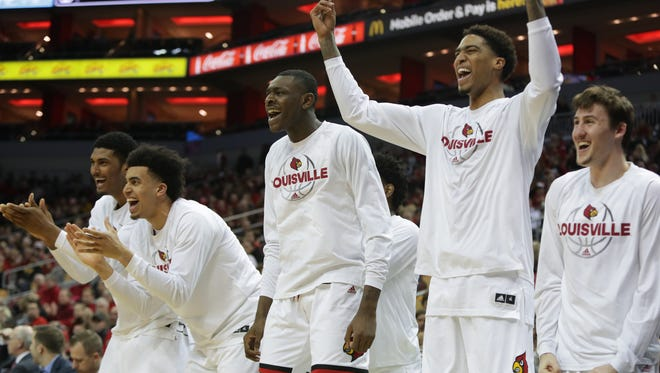 Louisville's bench cheers for their teammates during NIT action against Northern Kentucky. March 13, 2018.