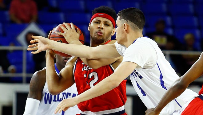 White's Creek's Rashaun Richardson protects the ball as he's pressured by Hamilton's  James De jesus during their Division l Class AA playoff game at Middle Tennessee State University's Murphy Center Thursday, March 15, 2018 in Murfreesboro, Tenn. (Photo by Wade Payne, Special to the Tennessean)
