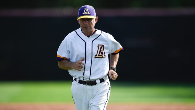 Lipscomb Academy baseball coach Ernie Smith  leads his team during a game at Brentwood Academy Friday, May 11, 2018, in Brentwood, Tenn.