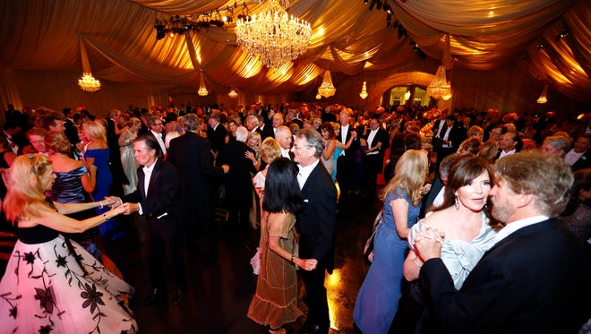 Attendees dance to Boz Scaggs as he performs at the annual Swan Ball Saturday, June 2, 2018 in Nashville, Tenn.