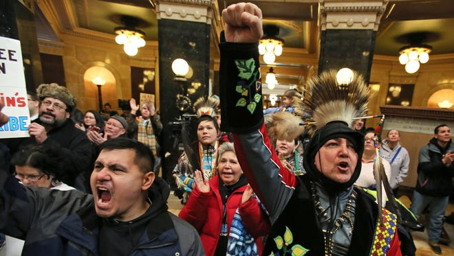 Vyron Dixon, left, of the Menominee Tribal Legislature, and Basil BW O'Kimosh, right, a member of the Menominee Tribe, react to one of the speakers during a rally at the Ssate Capitol in Madison earlier this month. The Menominee Nation's attempt at persuading Gov. Scott Walker to change his mind and approve the tribe's plans for a Kenosha casino fell flat after a police officer refused to let the tribal chairman into the governor's office.