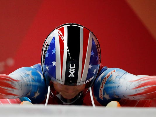 Emily Sweeney of the United States prepares for the start of her second run during the women's luge competition at the 2018 Winter Olympics in Pyeongchang, South Korea, Monday, Feb. 12, 2018. (AP Photo/Andy Wong)
