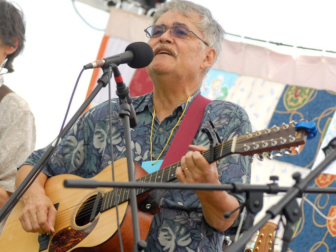 Dean Barnett, with the band, Lost Cuzzins, performs a song, Mon, Sept 1, during the BlueChiliGrass Festival at Goodells County Park.