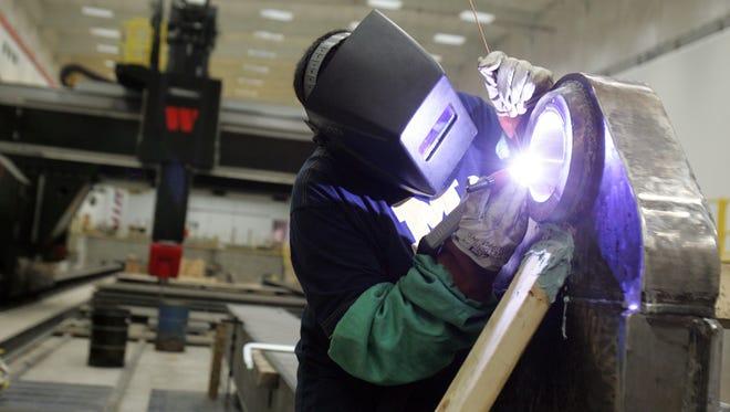 Arturo Lopez, of Detroit is pictured in June 2009 working as a certified welder for W Industries in Detroit.