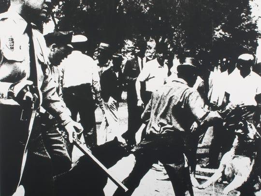 'Birmingham Race Riot, 1964,' is drawn from the portfolio