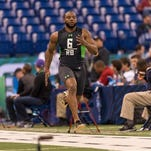Kenneth Dixon (28) ran a 4.58 40-yard dash during Friday's NFL Combine.