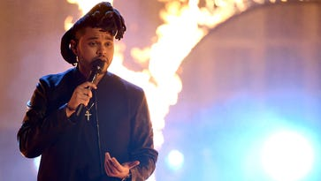 LOS ANGELES, CA - NOVEMBER 22:  Singer The Weeknd performs onstage during the 2015 American Music Awards at Microsoft Theater on November 22, 2015 in Los Angeles, California.  (Photo by Kevin Winter/Getty Images) ORG XMIT: 591261857 ORIG FILE ID: 498357758