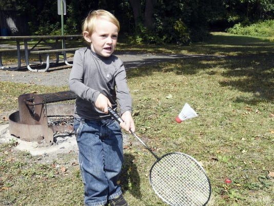 Three-year-old Devin Strass, son of  Scott Strass of Myerstown, plays a little badminton at Stoever's Dam Park in September.
