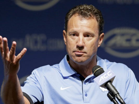 North Carolina football coach Larry Fedora responds to questions during the ACC kickoff in Pinehurst, N.C., on Tuesday.