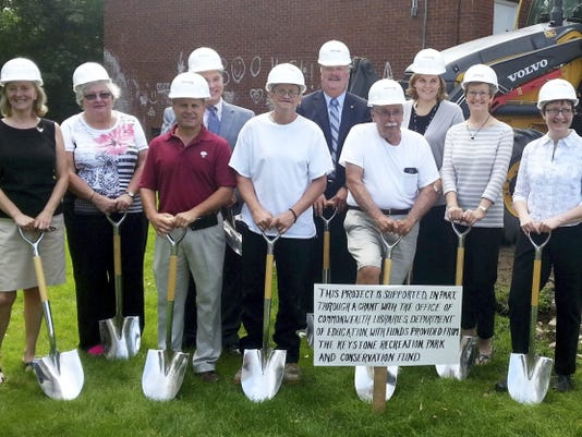 A ceremonial ground-breaking on Friday, July 10, 2015,  marked the start of a renovation and expansion at Shippensburg Public Library. Included in the event were: Jody Cole, library director; Paula Yasenchak, president of Friends of Shippensburg Public Library; Philip Fague, vice-president of Orrstown Bank; Gary Eichelberger, Cumberland County Commissioner;  Bill Johnston, library facilities manager; Rep. Mark Keller (R-86); Bruce Hockersmith, mayor of Shippensburg and capital campaign co-chairman; Stacy Gregson, representing Sen. Rich Alloway (R-33);  Jo Anne Coy, Library Board of Trustees president and capital campaign co-chairwoman; and Susan Sanders, past library director.