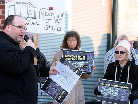 Democratic Party of York County chairman Chad Baker talks during a rally outside state Sen. Scott Wagner's York office Friday, Nov. 13, 2015. Protesters gathered to act on Wagner's comment regarding the election of Democrats to state judicial seats. He said before the election that if Democrats were seated, which they were, Pennsylvanians should pack their bags and move. The group brought a moving van suggesting Wagner should move. Bill Kalina - bkalina@yorkdispatch.com