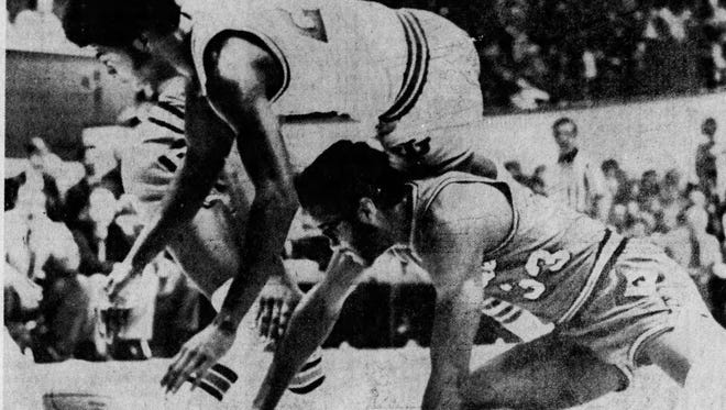 Indiana's Bobby Wlkerson dives over Purdue's Michael White.