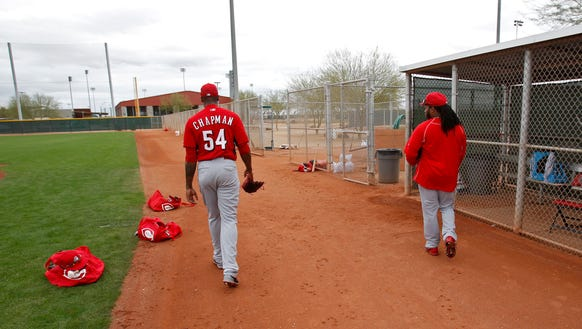 Reds closer Aroldis Chapman (left) and starting pitcher