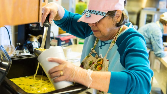 Liz Danielli pours soup for the Feed My Sheep program at Mariner's Bethel United Methodist Church in Ocean View on Thursday, December 7th.