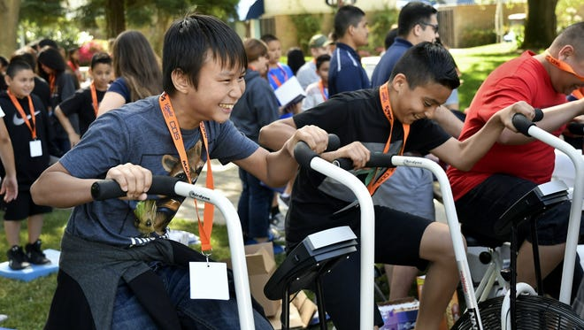 Visalia Unified School District six graders test out exercise equipment at a college and career readiness event at College of the Sequoias on Friday, May 11, 2018.
