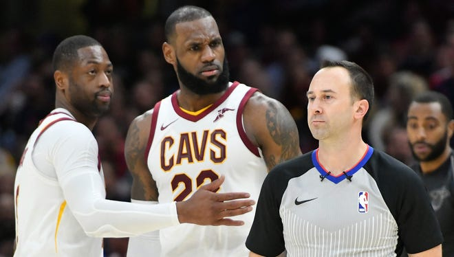 Cleveland Cavaliers forward LeBron James (23) reacts with Dwyane Wade (9) after he was ejected by referee Kane Fitzgerald.