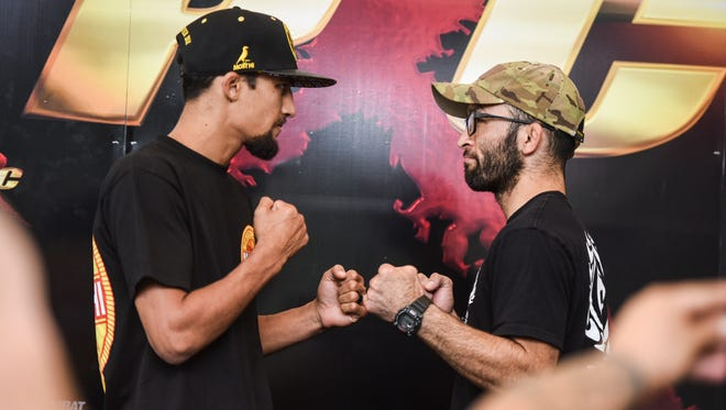Pacific X-Treme Combat contenders Riley Dutro, left, and Darren Uyenoyama square off for photographers after a press conference at the Pacific Islands Club in Tumon on Wednesday, Nov. 16, 2016. Both combatants are slated to compete in a world flyweight title fight during PXC 55 at the University of Guam Calvo Field House in Mangilao on Friday, Nov. 18. Final confirmation of the match will depend on the weigh-in of the fighters on Thursday, Nov. 17.