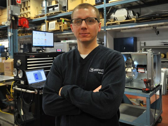 Product development engineering Nathan Fetting, 28, of Wausau, poses for a photo Thursday, April 2, 2015, at Greenheck Fan Corporation in Schofield.