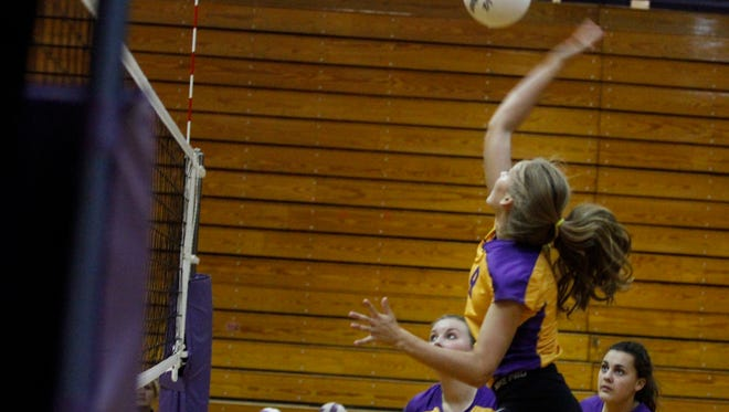 Clarksville High's Hannah Goins was strong at the net Tuesday as the Lady Wildcats beat Kenwood in three straight games to win their opening round matchup of the District 10 Tournament Tuesday at Clarksville High School