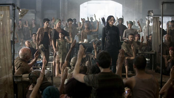 "A scene from ""The Hunger Games: Mockingjay Part 1,"" in theaters now. The movie filmed partly in Atlanta. Look for Asheville actress Jennifer Trudrung to the right of Jennifer Lawrence's Katniss. She's sitting and wearing a red bandana."