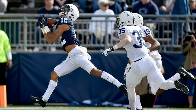 Penn State wide receiver Mac Hippenhammer makes a catch for a touchdown during the school's Blue-White spring football game Saturday, April 21, 2018,  in State College, Pa. (Abby Drey/Centre Daily Times via AP)