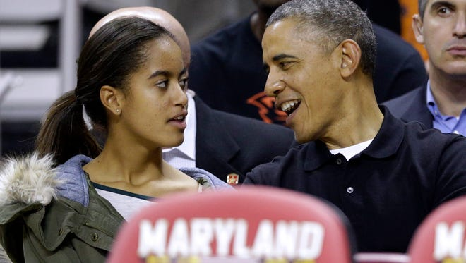 President Obama and daughter Malia at a basketball game in November.