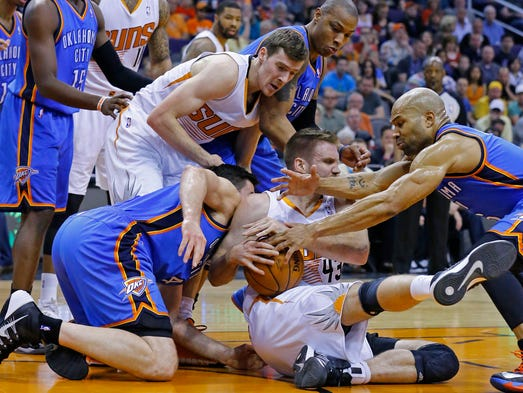Phoenix Suns forward Shavlik Randolph (43) tries to control a loose ball against the Oklahoma City Thunder during the first half of their NBA game Sunday, April 6, 2014 in Phoenix, Ariz.