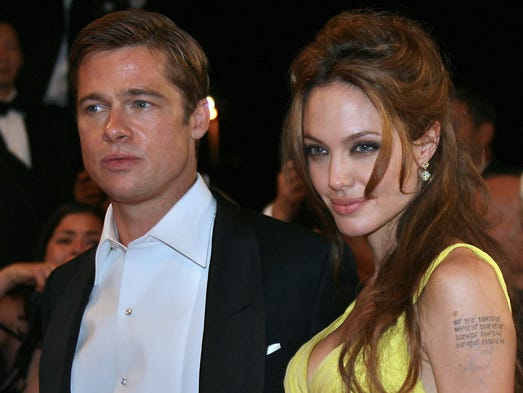 Angelina Jolie and Brad Pitt pose 24 May 2007 upon leaving the Festival Palace in Cannes, southern France, after the premiere of US director Steven Soderbergh's film 'Ocean's 13' during the 60th edition of the Cannes Film Festival. The film is presented in the Out of Competition category.