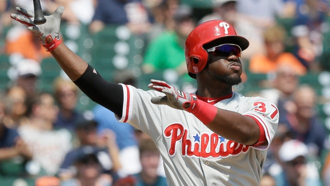 Philadelphia Phillies' Odubel Herrera flips his bat after a three-run home run during the fourth inning against the Detroit Tigers on Wednesday.