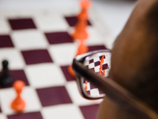 Hailey Mize, 15, eyes the board during a chess match