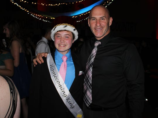 Baylor Lubelski was named Delsea Regional High School's homecoming king during the school's homecoming dance. He is pictured with Paul Berardelli, Delsea Regional High School principal, following the announcement.
