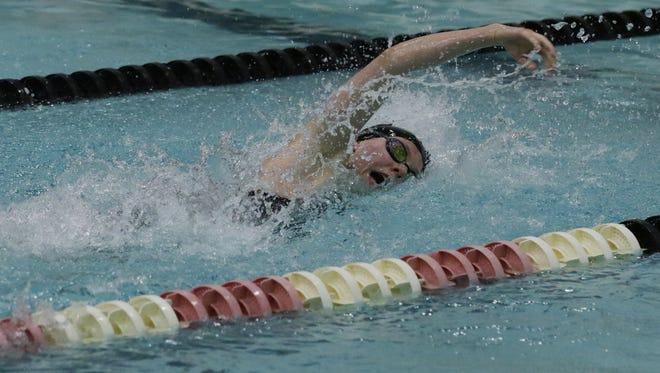 Menominee Fall/Sussex Hamilton sophomore Cassie Stegner swims to first-place finishes in the 100- and 200-yard freestyles during girls Division 1 state meet on Saturday at the UW Natatorium in Madison.