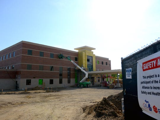Work continues on the Sparrow health center on Grand