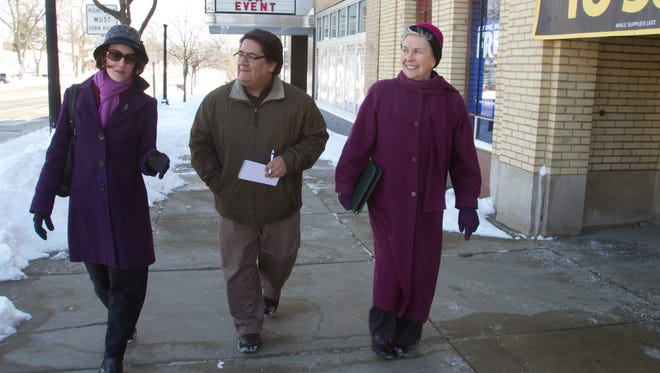Livingston Daily reporter Noé Hernandez is given a tour of downtown Howell businesses from Howell DDA director Cathleen Edgerly, left, and Chamber president Pat Convery.