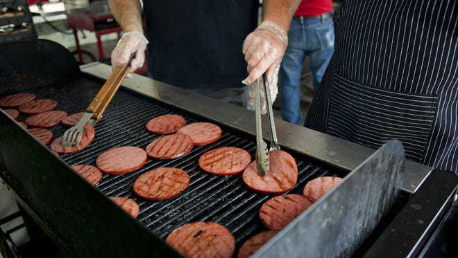 Slices of bologna are cooked on a grill during the Yale Bologna Festival. Outdoor cooking comes with its own set of safety rules. This year's festival is July 27-29.