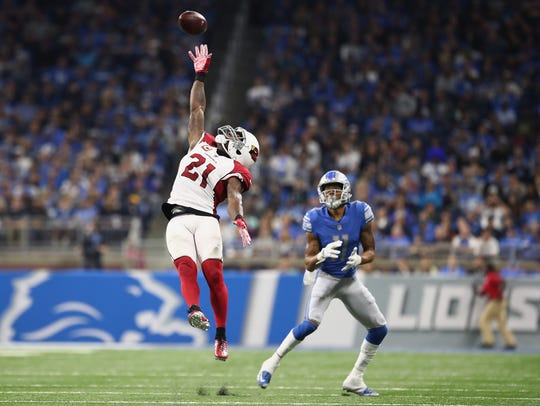 Cardinals CB Patrick Peterson tries to defect a pass