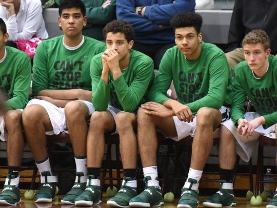 The Novi bench looks a bit down after watching West
